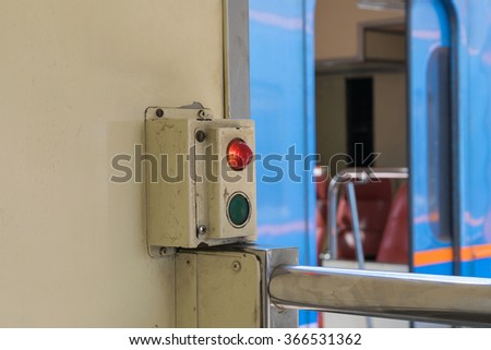 Cabin of a Public Thai Train Railway with door control button. This is a public train Does not require a property release.