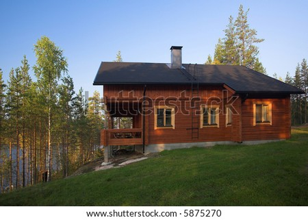 Cabin on the edge of a lake - stock photo