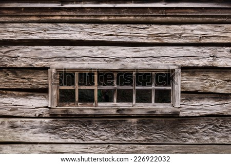"""Cabin window of the Noah """"Bud"""" Ogle Place along the Roaring Fork Motor Nature Trail in Great Smoky Mountains National Park, Tennessee - stock photo"""