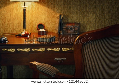 Cabinet Still Life In The Soft Light Of A Desk Lamp - stock photo