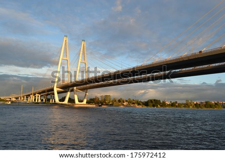 Cable-braced bridge across the river Neva at evening, St. Petersburg, Russia