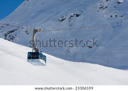 Cable car against beautiful landscape showing mountains in the swiss alps - stock photo