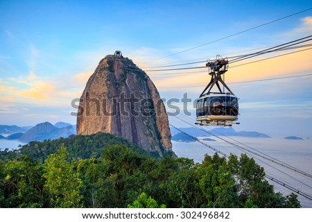 Cable car and  Sugar Loaf mountain in Rio de Janeiro - stock photo