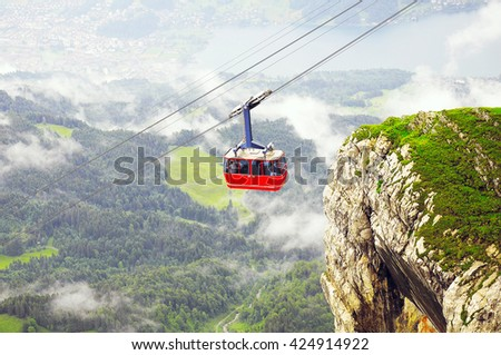 Cable car approach to the top of Pilatus mountain from Luzern. Switzerland. - stock photo