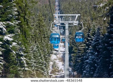Cable car lift at alpine ski resort Bansko, Bulgaria - stock photo