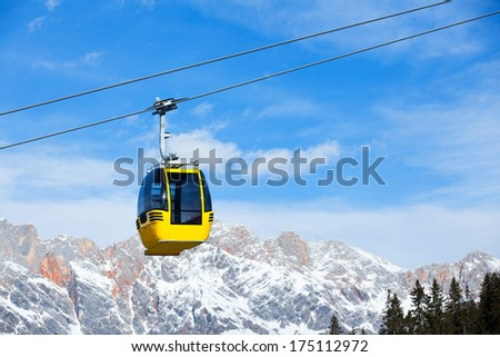 Cable car on the ski resort in Austria. On the background blue sky.