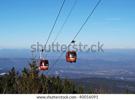 Cable car over mountain landscape. Rila mountains, ski resort Borovets, Bulgaria - stock photo