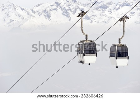 Cable cars on a background of mountains - stock photo