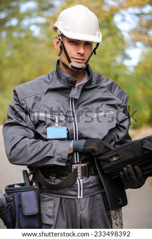 Cable guy prepairing for work - stock photo