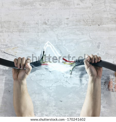 Cable in human hand. Power and connection - stock photo