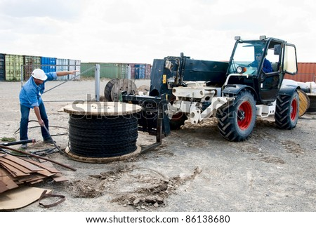 Cable loading on construction site - stock photo