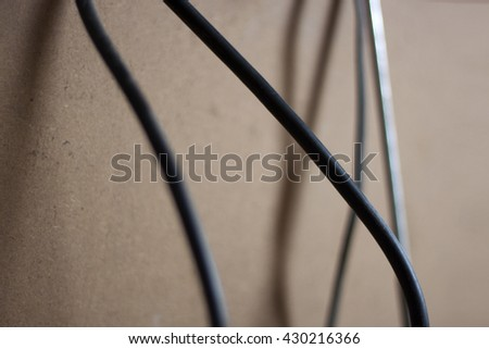 cable on wood background.
