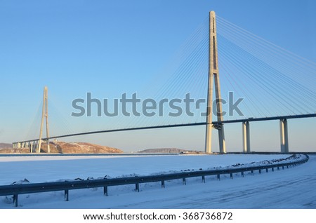 Cable-stayed bridge to island Russian in winter evening. Vladivostok, Primorsky Krai, Russia