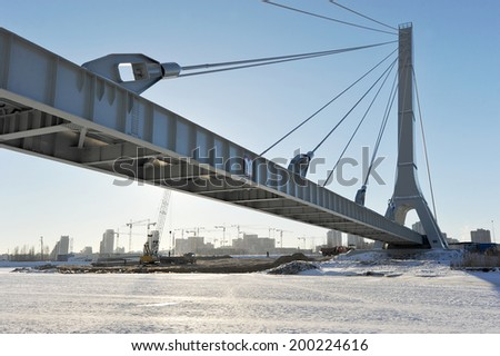 cable-stayed pipeline in St. Petersburg in winter - stock photo
