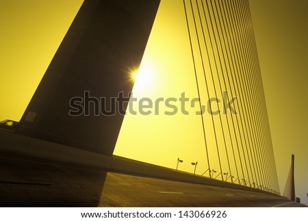 Cable tower of the Tampa Sunshine Skyway Bridge at sunset, Tampa Bay, Florida - stock photo
