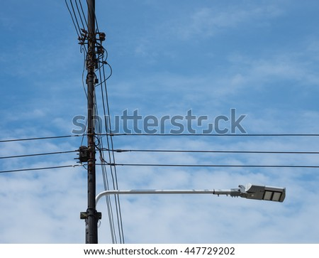 cable wiring branching, three phase low voltage transmission line on electrical pole with sky and cloud, electricity distribution system - stock photo