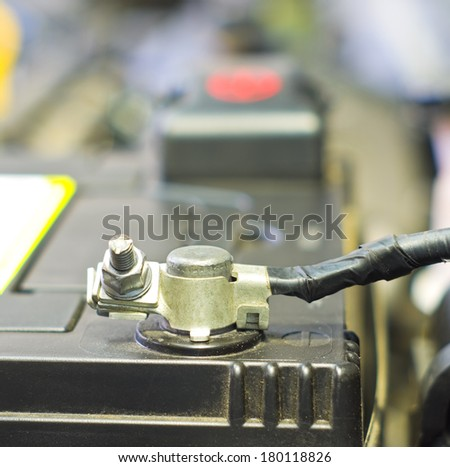 Cables connect to a car battery  - stock photo