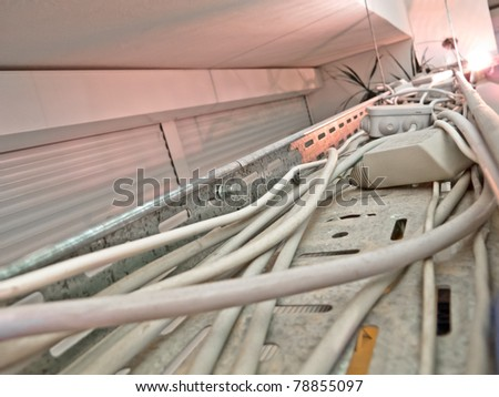 Cables on a metal rail - stock photo
