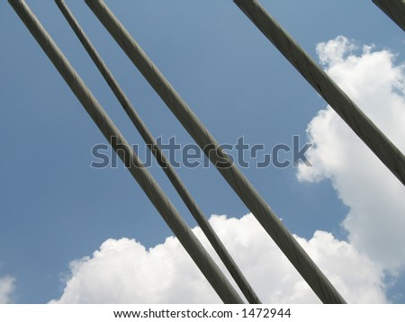 Cables under London Eye London - stock photo