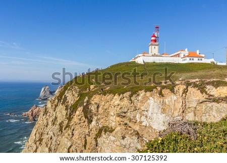 Cabo da Roca Cape Roca lighthouse and cliffs. - stock photo