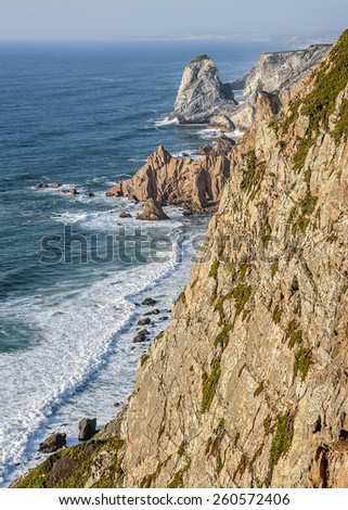 Cabo da Roca - the western promontory of the Eurasian continent , located in the territory of Portugal. Rock rises 140 meters above the Atlantic Ocean. - stock photo