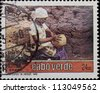 CABO VERDE-CIRCA 1990: A post stamp printed in Cabo Verde,shows villager doing traditional work, circa 1990. - stock photo