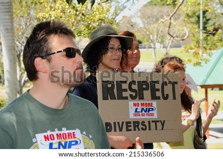 CABOOLTURE, AUSTRALIA - AUGUST 30: Unidentified protesters with anti government signs protesting immigration and same sex policies at March Australia Rally August 30, 2014 in Caboolture, Australia