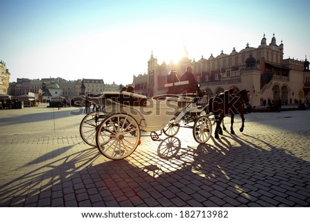 Cabs on the market in Krakow with a view of the hall - stock photo