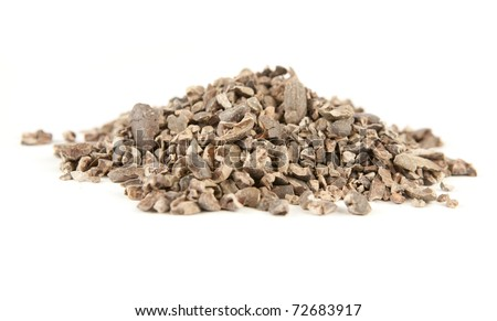 Cacao nibs isolated on white - stock photo
