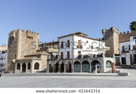 Caceres, Spain - March 16, 2016: Square of Caceres, Bujaco Tower, Chapel of Peace and bow of the Star in the Plaza Mayor.