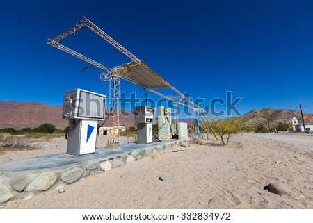 CACHI, ARGENTINA, DEC 24: Old abandoned petrol station against a blue sky on the famous gravel Ruta 40 (Route 40) in Cachi, near Cafayate, Salta Province. Argentina 2014 - stock photo