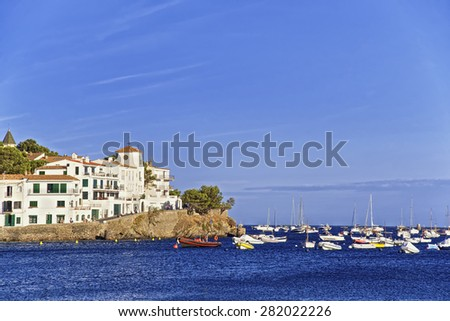 Cadaques harbor and cityscape in summer