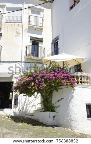 CADAQUES, SPAIN - JULY 27, 2017: Man sitting at a balcony of building  in Cadaques, Girona, Catalonia, Spain.