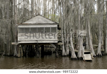 Caddo Lake sits on the Texas-Louisiana border and has a surreal feel of spanish moss and cypress trees. - stock photo