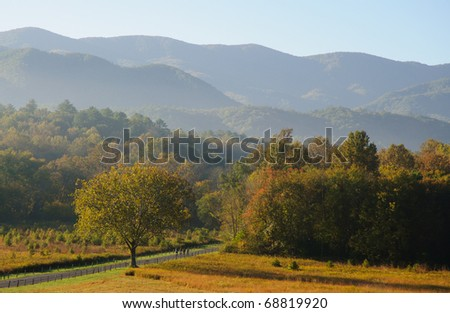 Cades Cove and mountains - stock photo