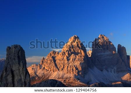Cadini di Misurina and Tre Cime di Lavaredo at sunset, Dolomite Alps, Italy - stock photo