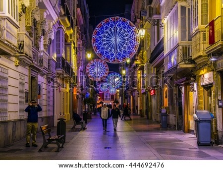 CADIZ, SPAIN, JANUARY 6, 2016: people are strolling over calle ancha street in historical center of spanish city cadiz during night