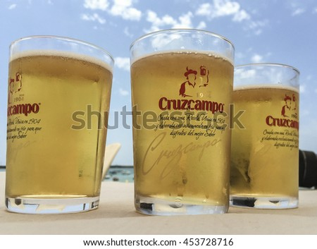 CADIZ, SPAIN - 07 JULY, 2016; Cruzcampo is a very popular local beer in Spain. Cruzcampo was established in the early 1900â??s by male siblings and today it is the biggest selling beer in Spain.