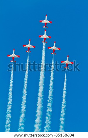 CADIZ, SPAIN-SEPT 9: Aircrafts of the Patrulla Aguila take part in a test on the 4th airshow of Cadiz on Sept 9, 2011, in Cadiz, Spain