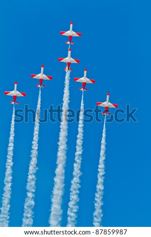 CADIZ, SPAIN-SEPT 9: Aircrafts of the Patrulla Aguila taking part in a test on the 4th airshow of Cadiz on Sept 9, 2011, in Cadiz, Spain