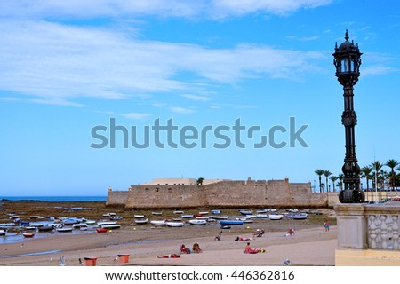CADIZ, SPAIN - SEPTEMBER 29, 2015: La Caleta beach with the Santa Catalina Castle in the background, Cadiz, Andalusia, Spain