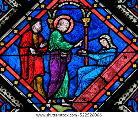 CAEN, FRANCE - FEBRUARY 12, 2013: Stained Glass window in the Cathedral of Caen, Normandy, France, depicting Saint John the Evangelist and Mother Mary