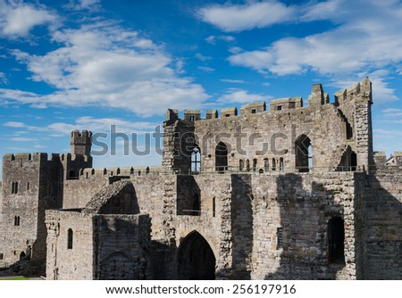 CAERNARFON, WALES - 29 SEPT. 2013: View on the remnants of Caernarfon Castle. The castle is a major landmark in Wales and attracts thousands of tourists each year - stock photo