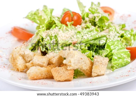 Caesar salad dish closeup isolated on a white background - stock photo