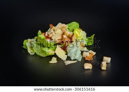 Caesar salad isolated on black - stock photo