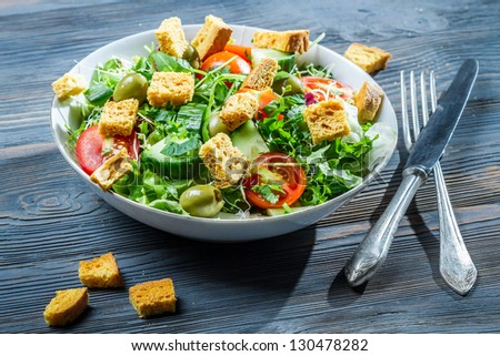 Caesar salad made of fresh vegetables - stock photo