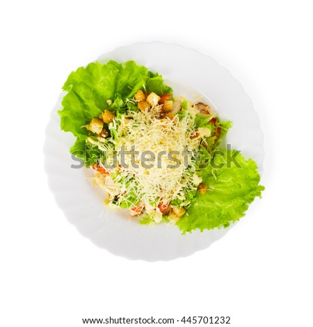 Caesar Salad on a plate isolated on white background