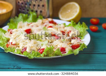 Caesar Salad on a serving plate on a table - stock photo