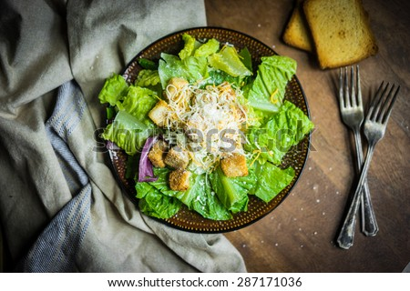 Caesar salad on rustic background - stock photo