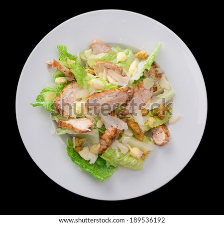 Caesar salad with chicken and greens. - stock photo